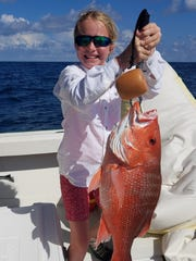 Nine-year-old Meghan Lawler with her first red snapper out of Cape San Blas. It weighed 10 pounds.  Will Lawler photo