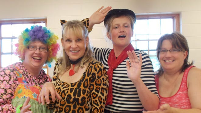Sound Celebration members practice for their upcoming Oct. 17-18 circus-themed shows. From left: Cinda Langhoff of Sheboygan, Kate Pearce of Cascade, Amy Huibregtse of Plymouth and Julie Lawonn of Glenbeulah.