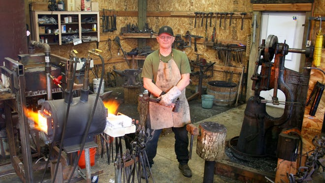 Tony Fetters in his shop.