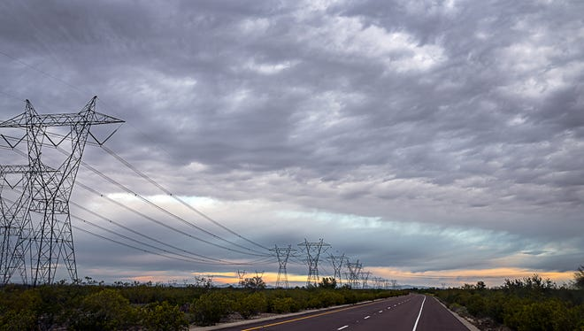 Archie Tucker was energized to grab his camera when he saw this transmission line in Buckeye on a cloudy day in March.