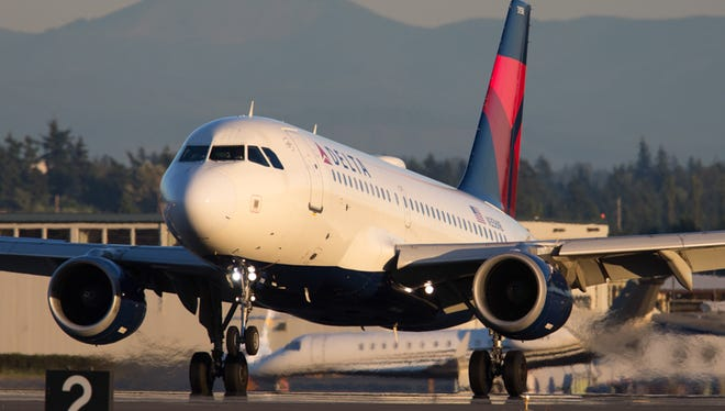 A Delta Air Lines Airbus A319 lands at Seattle-Tacoma International Airport in July 2017.