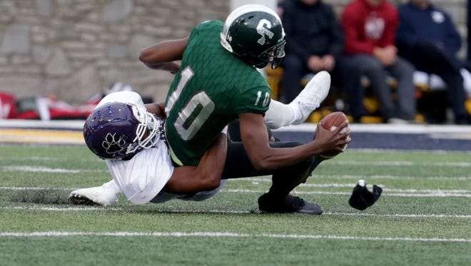 Detroit Cass Tech quarterback Aaron Jackson gets sacked by Pickerington (Ohio) Central during Cass Tech's 24-21 loss at the University of Toledo on Friday, Aug. 24, 2017.