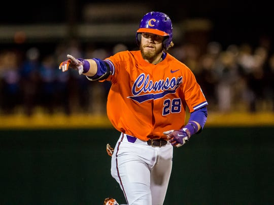 Clemson Tigers right fielder Seth Beer (28) rounds the bases following his two-run homer against the South Carolina Gamecocks during the sixth inning at Founders Park.
