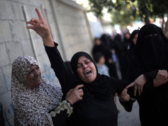 Palestinian women mourn at the family house of Ahmed