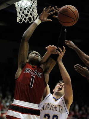 New Albany's Romeo Langford (left) battles for a rebound against Castle's Payton Mills (32) on Saturday in the 2017 IHSAA 4A Regional Basketball Final at Seymour High School. (Photo by David Lee Hartlage, Special to The Courier-Journal) Mar. 11, 2017