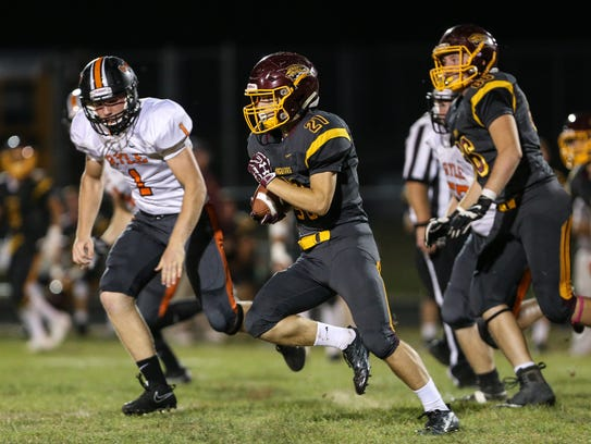 Anthony Witschey carries the ball for Cooper during