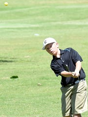 White House 12-year-old Colton Werner chips on to the green during his round on Wednesday morning.