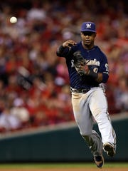 Milwaukee Brewers shortstop Jean Segura (9) makes a play during the eighth inning of a baseball game against the St. Louis Cardinals at Busch Stadium on Saturday.