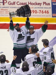 Mathieu Roy and Cedric McNicoll of the Florida Everblades celebrate their win over the Las Vegas Wranglers in Game 5 of the Kelly Cup Finals on Wednesday, May 23, 2012, at Germain Arena in Estero.