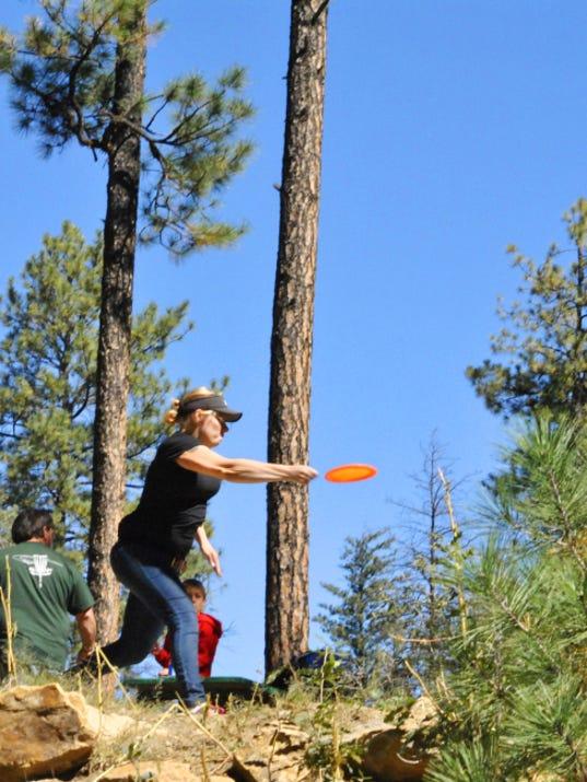 Dara Whitlock gives a mighty toss from the No. 7  tee.