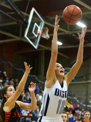 Great Falls High's Nora Klick grabs a rebound during Friday evening's playoff game in against Billings Senior in the Swarthout Fieldhouse.