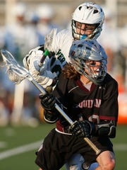 Tower Hill's James Spruance (top) goes for a stick check on Appoquinimink's  Dominic Barrera in the second half of Appoquinimink's 12-8 win in a semifinal of the DIAA state tournament Wednesday at Caravel Academy.