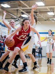 St. Philip's Maya Segovia (20) drives to the hoop during
