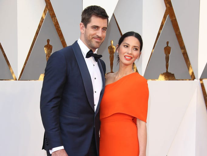 Aaron Rodgers (Green Bay Packers QB) and Olivia Munn