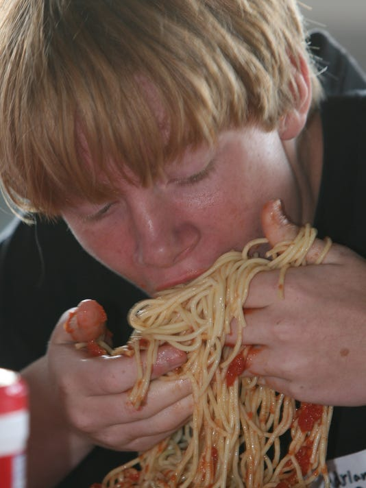 sch co ital am fest spaghetti eating contest.jpg