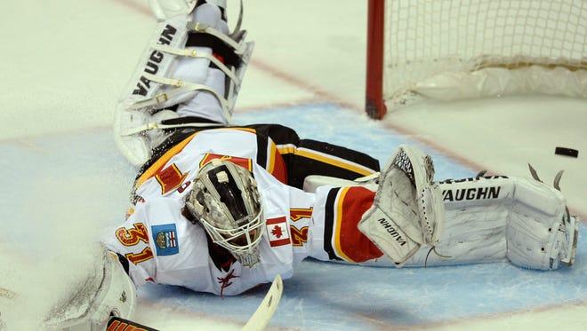 Calgary Flames goalie Karri Ramo is unable to make a save off of a shot by Anaheim Ducks left wing Matt Beleskey.
