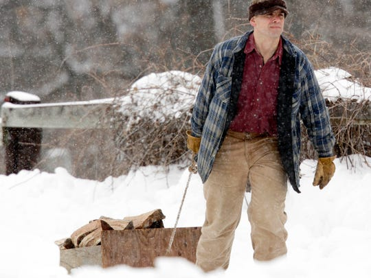 Michael Perry, hauling wood at his home near Eau Claire
