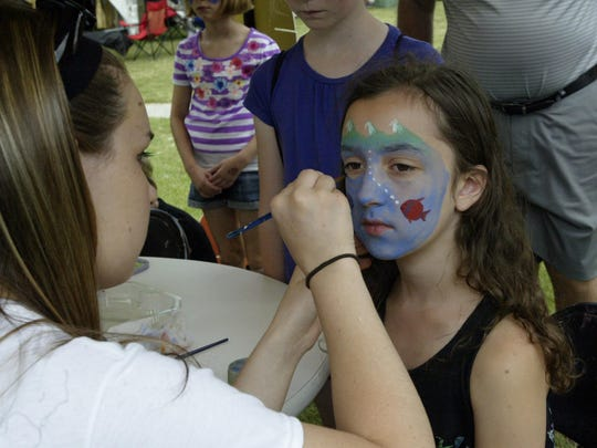 Madeline Theune gets her face painted at the John Michael Kohler Arts Center during last year's Midsummer Festival of the Arts.