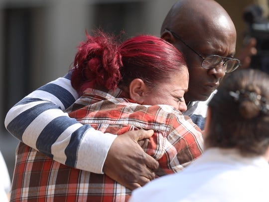 Erica Perez, the mother of Ciara Grimes, is comforted outside of Rochester City Court where a teen accused of killing Grimes was arraigned. Grimes, 18, was fatally shot allegedly by her boyfriend on May 9, 2018.