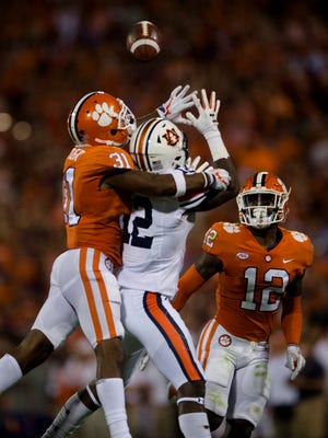 Clemson cornerback Ryan Carter (31) deflects a pass intended for Auburn wide receiver Eli Stove (12) during the NCAA football game between Auburn and Clemson on Saturday, Sept. 9, 2017, in Clemson N.C.
