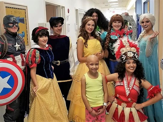Bella Ochoa, center, with some Disney and Marvel characters at El Paso Children's Hospital.