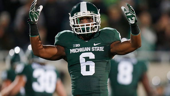 Former MSU defensive back Mylan Hicks, shown here in a game against Nebraska in 2014, was shot and killed Sunday in Calgary.