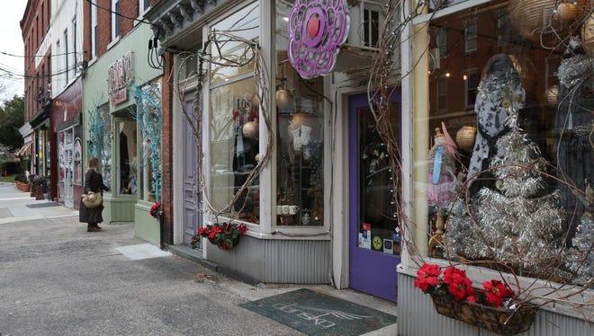 A shopper walks into the Maria Luisa Boutique in downtown Nyack Dec. 8, 2014.