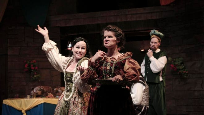 """Abigail Bailey Maupin as Katherina, Maggie Lou Rader as the widow and Gregory Maupin as Petruchio in Kentucky Shakespeare's """"The Taming of the Shrew."""""""