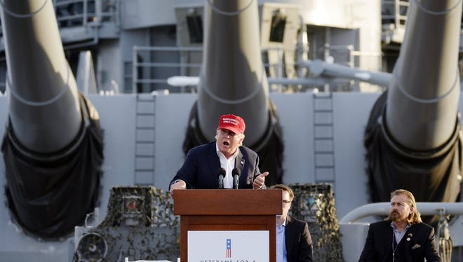 The retired ship the USS Iowa is the backdrop for Donald Trump, Los Angeles, Sept. 15, 2015.
