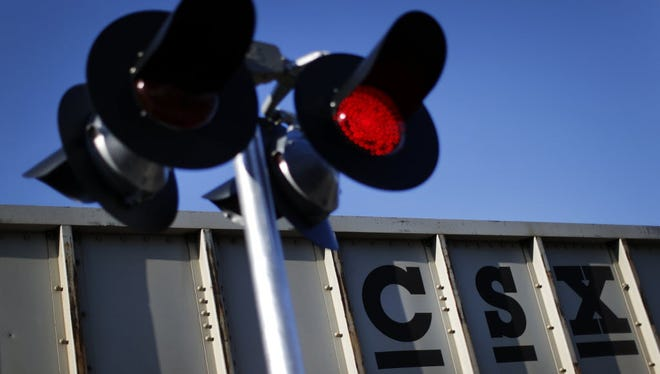 In this March 22, 2014 picture, a CSX freight train rolls past a grade crossing in Mt. Airy, Md. Federal authorities are investigating the theft of 32 cases of commercial-grade fireworks Friday, April 22, 2016.