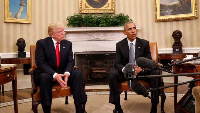 In this Nov. 10, 2016 file photo, President Barack Obama meets with President-elect Donald Trump in the Oval Office of the White House in Washington.