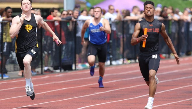 Michael Huertas (right) competes in 100 meters, 200, triple jump and anchors the 4-x-400 relay for Fort Lee.