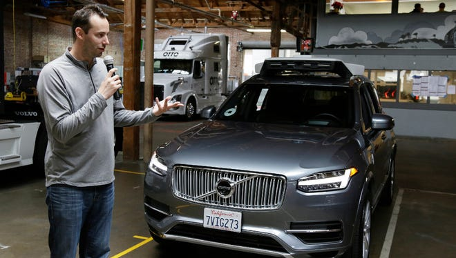Anthony Levandowski, shown here during a briefing at a garage owned by his self-driving truck company Otto, which Uber bought in 2016.