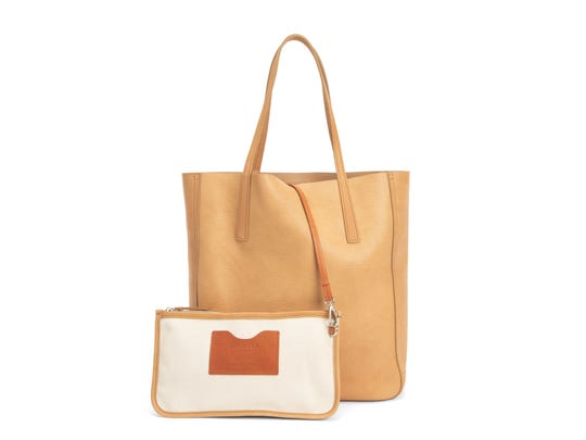 American-made Medium Shopper Tote in pressed-back Horween Essex leather. Handcrafted with nickel-plated brass hardware, and featuring two open interior gusset pockets, canvas removable zip pouch with leather trim and signature bold orange exterior leather card case pocket. Individually numbered with cut-painted edges.