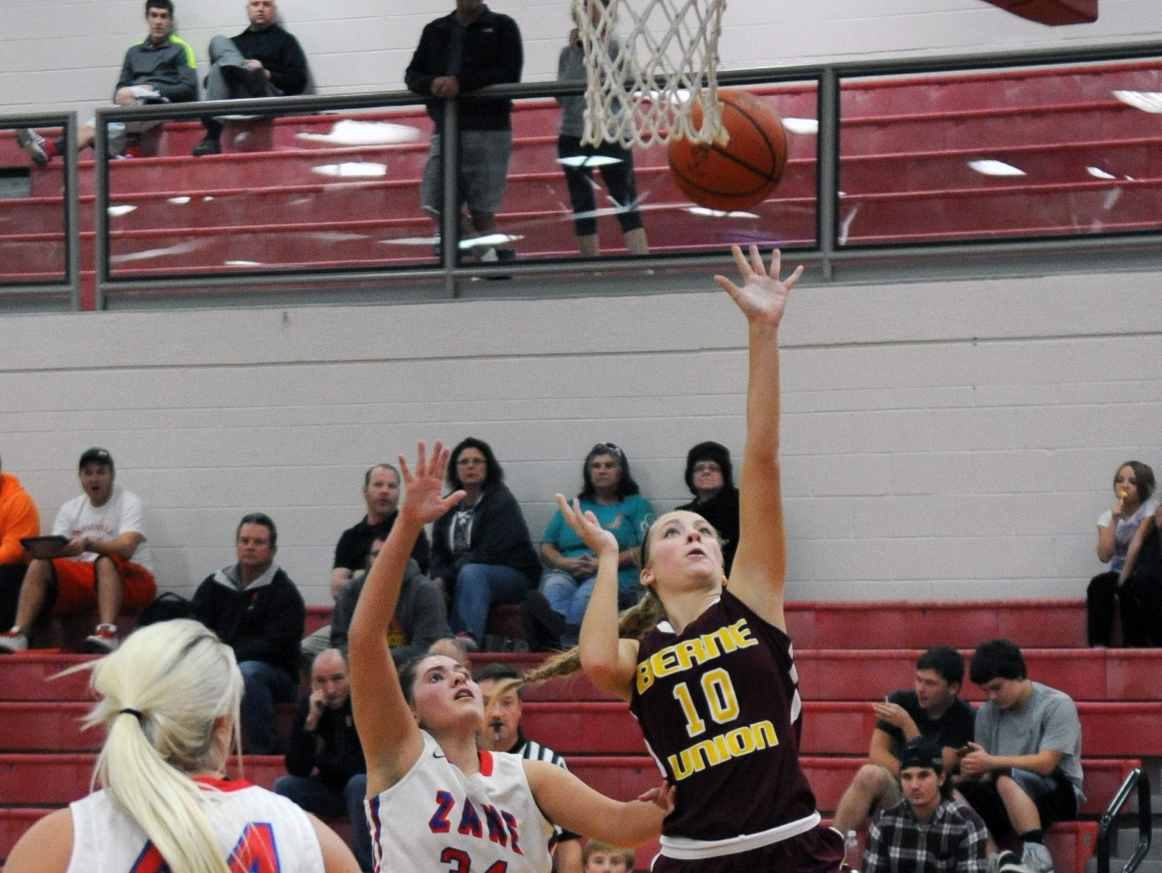 Berne Union's Madison Ross jumps up for a shot against Zane Trace Friday at Zane Trace High School.