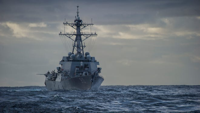 The Arleigh Burke-class guided-missile destroyer USS Roosevelt prepares to do an underway replenishment with the Military Sealift Command fleet replenishment oiler USNS Big Horn.