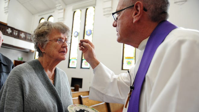 In a short midday service of worship, Salinas native Jerry Conley receives a cross of ashes from Jim Luther at the First United Methodist Church in 2015.
