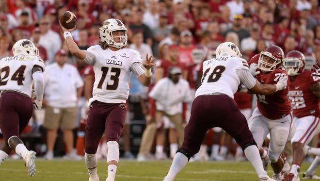 Garrett Smith (13) established another career-high by throwing a 73-yard touchdown pass to R.J. Turner against Oklahoma last Saturday.