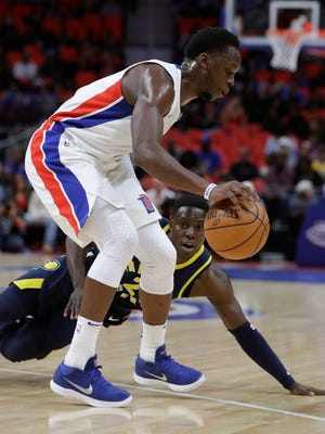 Detroit Pistons guard Reggie Jackson controls the ball after Indiana Pacers guard Darren Collison attempted a steal during the first half of an NBA basketball game, Wednesday, Nov. 8, 2017, in Detroit.