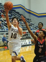 Wylie's Steven Lopez, left, drives to the basket as