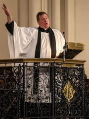 The Rev. Steven Kelly preaches the sermon during the Good Friday service at St. John's Episcopal Church in Detroit on Friday, March 30, 2018, which is the same day as Opening Day for the Detroit Tigers baseball team.