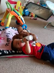 Isaiah Perez Pequeno, 18 months old, was happy to have his teddy bear back on Thursday, just two days after it was lost.