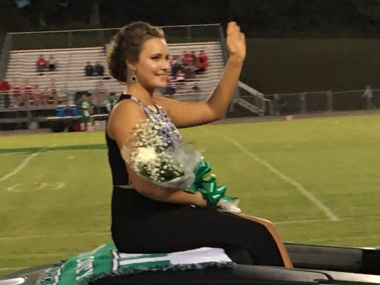 Lynzie Averitt, the 2017 Homecoming Senior Attendant has a wave and a smile for those attending the HCHS football game.