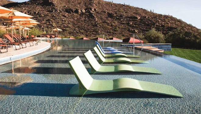 At the Ritz-Carlton Dove Mountain resort, the in-the-water lounge chairs at Turquesa pool offer a great way to relax while soaking up some sun.