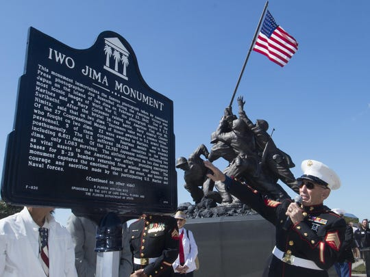 U.S. Marine Corps Sgt. George Colom describes a new plaque unveiled at a ceremony for the 70th anniversary of the Iwo Jima flag-raising in February. The memorial is part of the Heritage Trail.