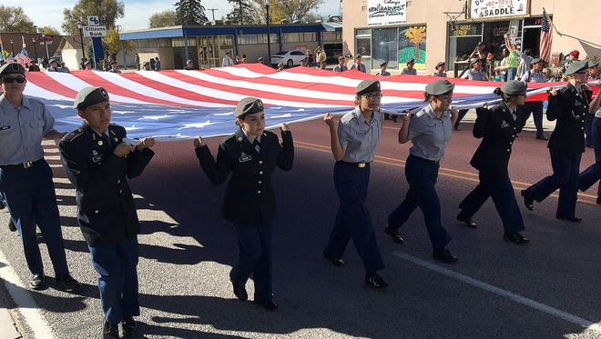 Participants march down Main Avenue during the Veterans Day Parade hosted by VFW Post 614 on Nov. 12 in Aztec.