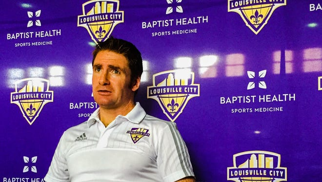 Louisville City FC coach James O'Connor speaks to reporters at Slugger Field.