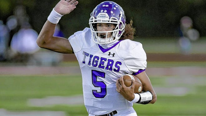 Garner Wallace, a Central senior and Northwestern commit, looks for running room during the visiting Tigers' 43-3 win over Groveport on Sept. 18. Wallace succeeded three-year starter Demeatric Crenshaw at quarterback this season.