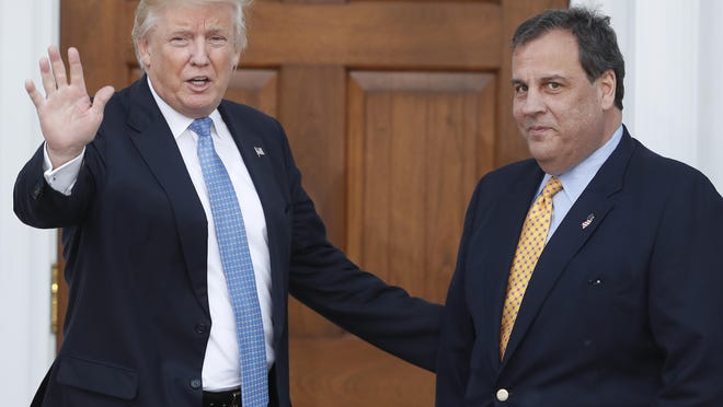 FILE - In this Nov. 20, 2016 file photo, President-elect Donald Trump, left, waves to the media as New Jersey Gov. Chris Christie arrives at the Trump National Golf Club Bedminster clubhouse, in Bedminster, N.J. Christie turned down several jobs in the Trump administration because his wife refused to move to Washington, the governor said Wednesday, Jan. 18, 2017. (AP Photo/Carolyn Kaster, File)