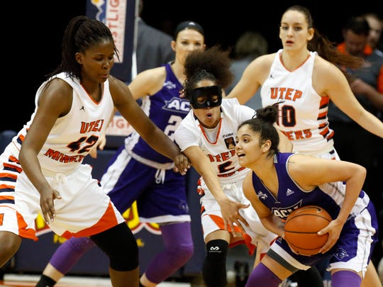 Abilene Christian guard Alexis Mason (with ball) is stopped by the Miners' defensive pressure applied by Tamara Seda and Cameasha Turner during first half action of their first round WNIT game played at the Don Haskins Center. UTEP came away with the win, 66-62, and will now play a second round game Monday night against Arkansas State.